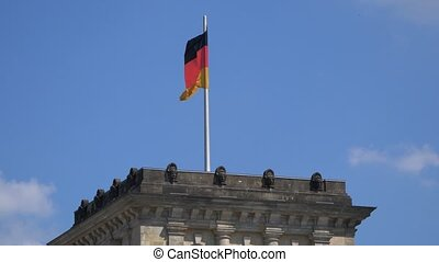 Germany Flag Fluttering Upon The Reichstag Building in Berlin, Zoom Out