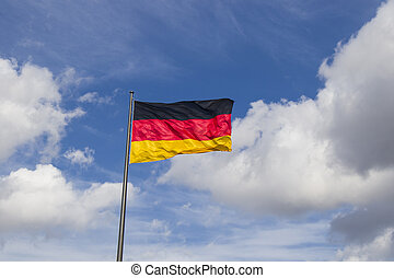 Germany flag on the blue sky background, Berlin