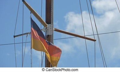 Germany Flag on Wooden Mast - Small Germany flag waving in...