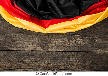 Germany Flag on wooden Table with copyspace