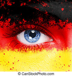 Germany flag painted on woman face