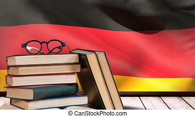 Germany flag waving behind wooden table