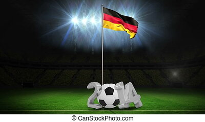 Germany national flag waving on pole with 2014 message on football pitch