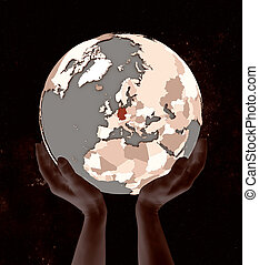 Germany on globe in hands