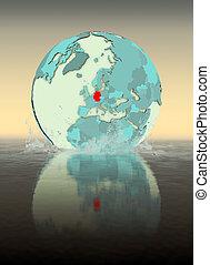 Germany on globe splashing in water