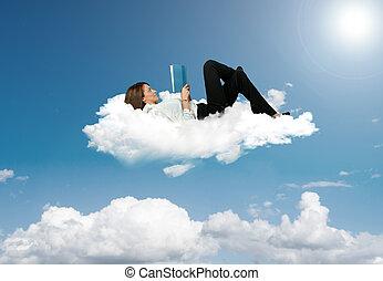 geschäftsfrau, lesen buches, in, a, wolke