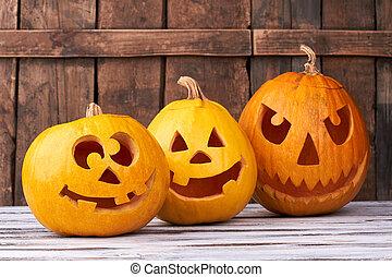 geschnitzte kürbisse, drei, halloween.