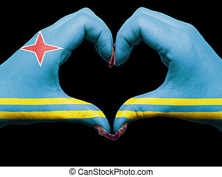 Gesture made by aruba flag colored hands showing symbol of heart and love