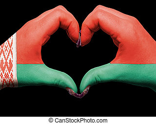 Gesture made by belarus flag colored hands showing symbol of heart and love
