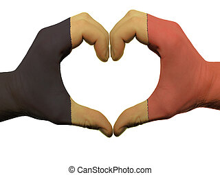 Gesture made by belgium flag colored hands showing symbol of heart and love, isolated on white background