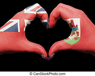 Gesture made by bermuda flag colored hands showing symbol of heart and love