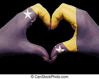 Gesture made by bosnia herzegovina flag colored hands showing symbol of heart and love