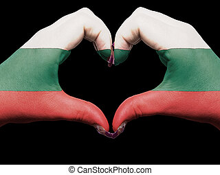 Gesture made by bulgaria flag colored hands showing symbol of heart and love