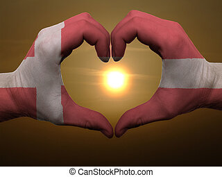 Gesture made by denmark flag colored hands showing symbol of...