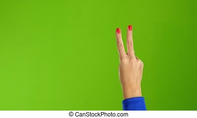 Gesture of peace shows arm woman back of the hand - Gesture...