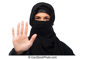 muslim woman in hijab showing stop sign - gesture, religious...