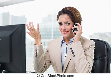 Gesturing businesswoman phoning