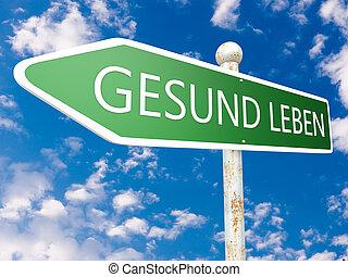 Gesund leben - german word for living well - street sign...