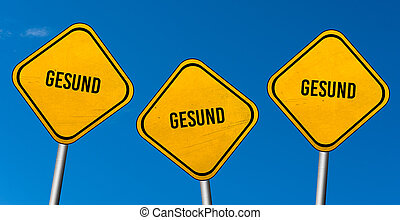 Gesund - yellow signs with blue sky