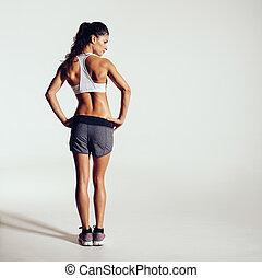 gesunde, junge frau, in, sportkleidung