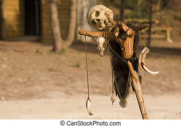 Get away - Bones and a skull marking the village