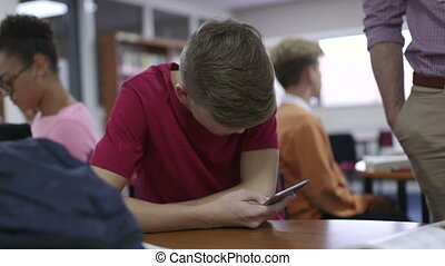 Get Back To Work - Teenage student gets caught using his...