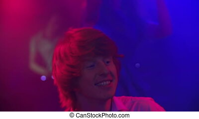Get Down - Close up of ginger haired guy having a ball at...