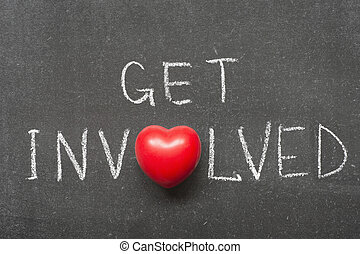 get involved phrase handwritten on school blackboard with heart symbol instead of O
