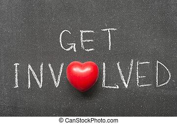 get involved phrase handwritten on school blackboard with ...