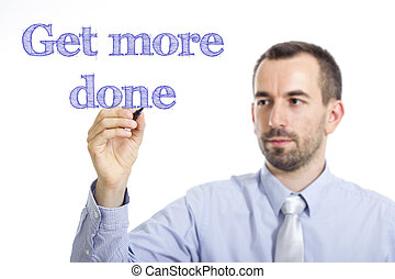 Get more done - Young businessman writing blue text on transparent surface