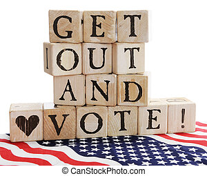 """Rustic alphabet blocks arranged to say, """"Get out and Vote!"""" sitting on a bed of stars and stripes. On a white background."""