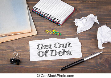 Get Out of Debt. paper sheet from the booklet on the wooden...