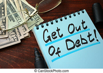 Get out of Debt written on a notepad with marker.