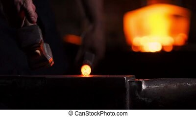 Get out of the furnace hot metal to make a sword war. Master...