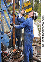 get that pipe right - Drilling crewmen position pipe on...