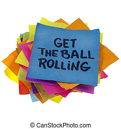 get the ball rolling - motivational slogan on a stack of...