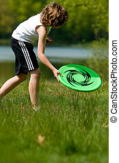 get the frisbee - young beauty boy is getting his frisbee