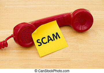 Getting a call that is an scam, A retro red phone with ...