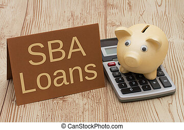 Getting a SBA Loan, A golden piggy bank, card and calculator...