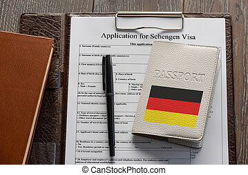 Application form, pen and a German passport - Getting a ...