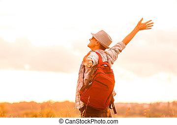 Getting away from it all. Man in open field relaxing looking...