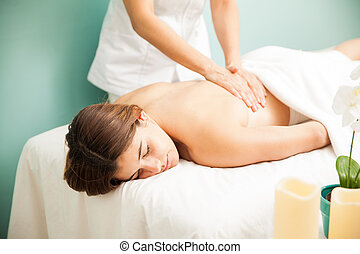 Getting back massage at a spa clinic