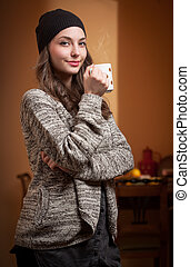 Getting cozy. - Portrait of a gorgeous young brunette woman...