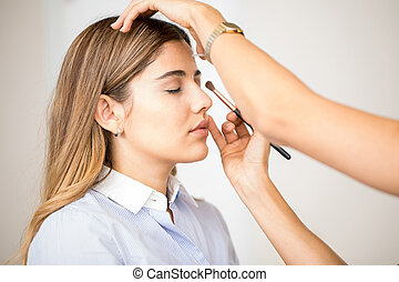 Getting make-up done at a salon