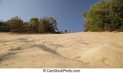 Getting Ready To Sand board, Qld Island