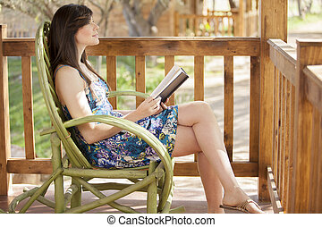 Getting some quiet time and reading - Gorgeous young woman...
