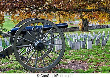 A cannon in a cemetery at Gettysburg National Military Park in Pennsylvania, USA.