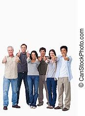 geven, het glimlachen, groep, beduimelt omhoog