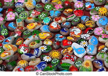 geverfde, symbolen, stenen