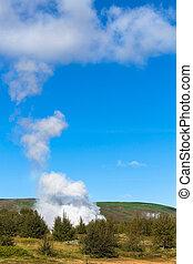 geyser eruption in Haukadalur valley in Iceland - travel to...